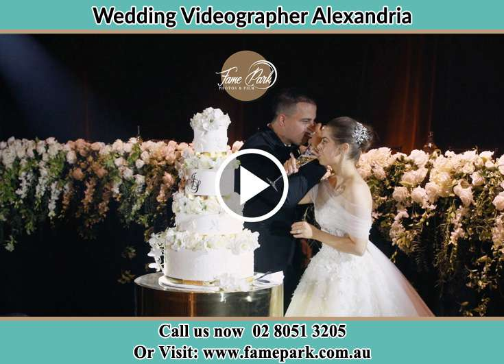 Bride and Groom drink beside their wedding cake Alexandria NSW 2015
