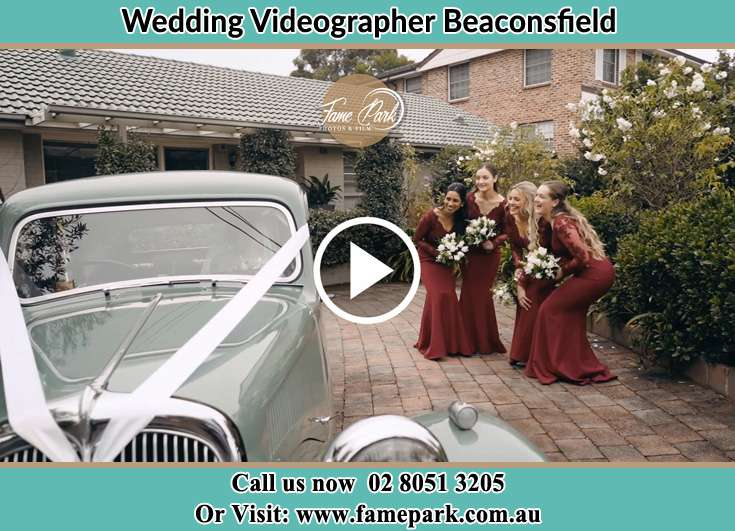 Bride's secondary sponsor near the bridal car Beaconsfield NSW 2015