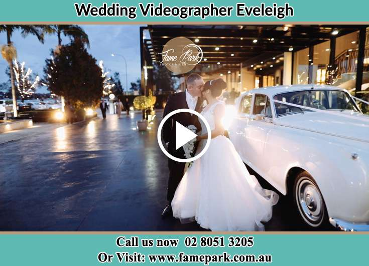 Bride and Groom kissed at the bridal car Eveleigh NSW 2015