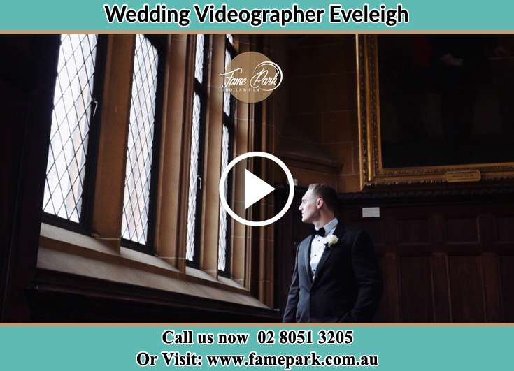 Groom looking at each window Eveleigh NSW 2015