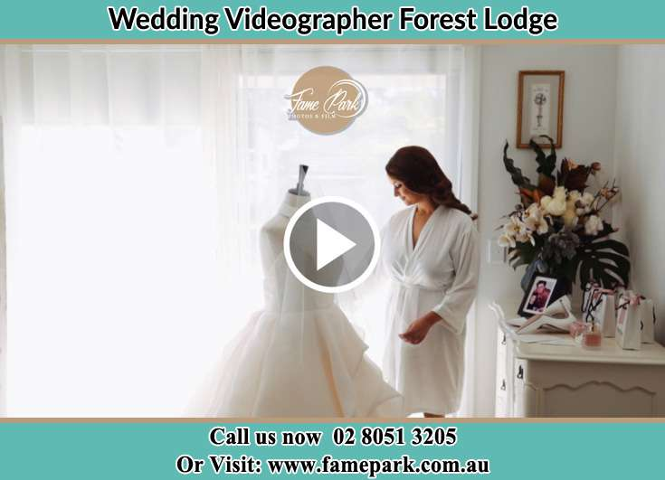 Bride looking at the wedding gown Forest Lodge NSW 2037