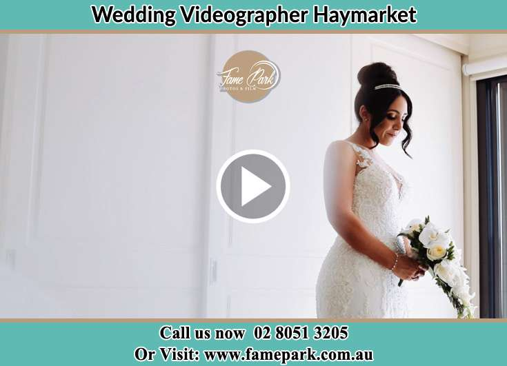 Bride with bouquet of flowers Haymarket NSW 2000