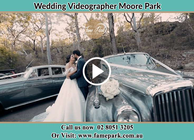 Bride and Groom looking at each other near the bridal car Moore Park NSW 2021