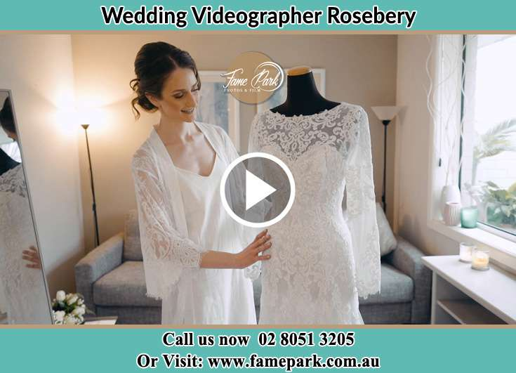Bride looking at her wedding gown Rosebery NSW 2018