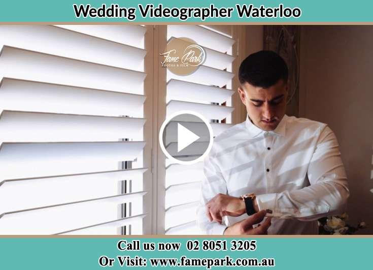 Groom looking at his watch Waterloo NSW 2017