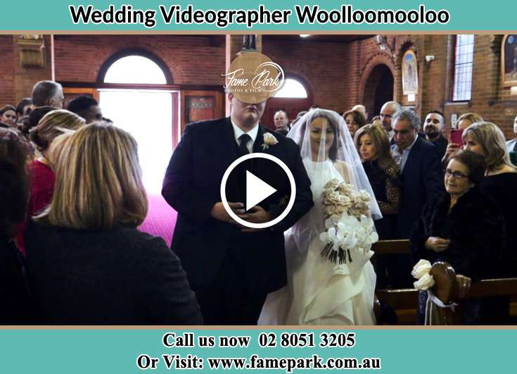 Bride and father walk in the aisle Woolloomooloo NSW 2011