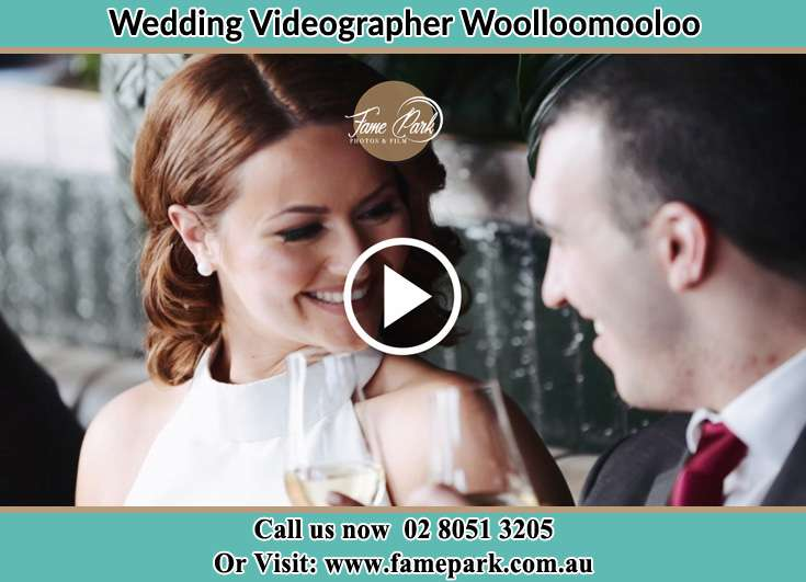 Bride and Groom looking at each other while making a toast Woolloomooloo NSW 2011